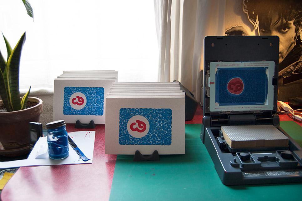 Gocco printing with finished prints on drying racks